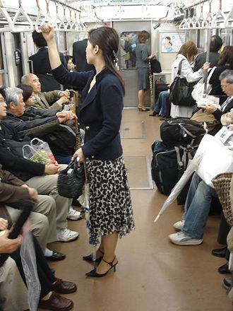 Office lady - An office lady on the Tokyo subway