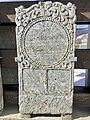 Old tombstones on display at the graveyard (kirkegård) by Sør-Fron Church (Gudbrandsdalsdomen kirke 1792) Hundorp Gubrandsdalen Norway 2017-03-23 Spring sun IMG 1961.jpg