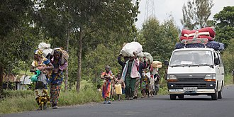 Population fleeing their villages due to fighting between FARDC and rebels groups, Sake North Kivu 30 April 2012 Opening ceremony of new PNC headquarters in Goma (7134901927).jpg