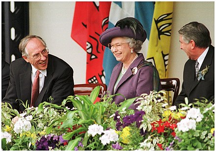The official reconvening of the Scottish Parliament in July 1999 with Donald Dewar, then First Minister of Scotland (left) with Queen Elizabeth II (centre) and Presiding Officer Sir David Steel (right) Opening of the Scottish Parliament, 1999.jpg
