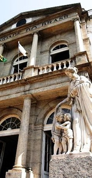 Federal University of Rio de Janeiro - University Palace, neoclassical building finished in 1842. In the foreground, the Charity Statue, symbol of piety towards the ill (the facility originally functioned as a hospice).