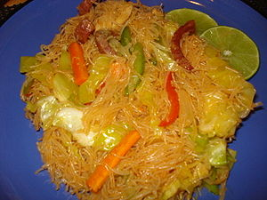 Very thin rice noodles fried with soy sauce an...