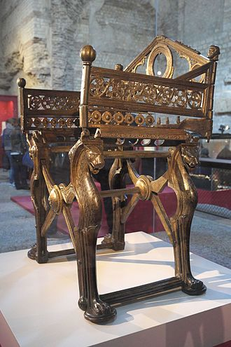 "Dagobert I - ""Throne of Dagobert"", bronze. The base, formed by a curule chair, is traditionally attributed to Dagobert, while the arms and the back of the chair were added under Charles the Bald. This throne was last used by Napoleon I in 1804 when he created the Legion d'Honneur. Cabinet des Medailles."