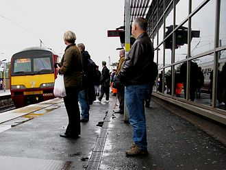 Partick station - Passengers join a westbound service