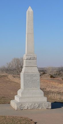 Square granite obelisk, 10–12 feet high
