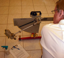 Pendulum floor friction tester in action