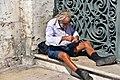 People watching in Lisbon (37158377375).jpg