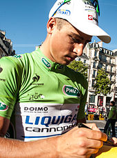 Peter Sagan wearing a green cycling jersey.
