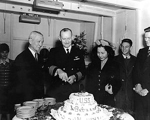 USS Bataan (CVL-29) - Captain Valentine H. Schaeffer, USN, the carrier's Commanding Officer, cuts the cake at a reception following her commissioning ceremonies, at Philadelphia, Pennsylvania, 17 November 1943. Looking on are Philippine Commonwealth Vice President Sergio Osmeña and Miss Rosie Osmeña.