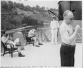 Photograph of members of President Truman's party enjoying the sun on the flying bridge of the President's yacht, the... - NARA - 198618.tif