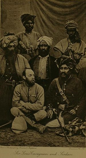 Pierre Louis Napoleon Cavagnari - Cavagnari sitting with a group of Afghan tribesmen.