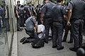 Police officer arbitrarily predating the photographer Caio Castor, São Paulo, 2015.jpg