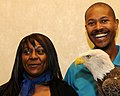 Posing for picture with Bald Eagle. (10594315574).jpg