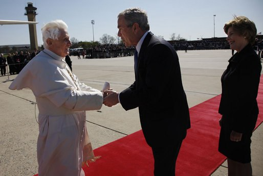 President George W. Bush takes the hand of Pope Benedict XVI