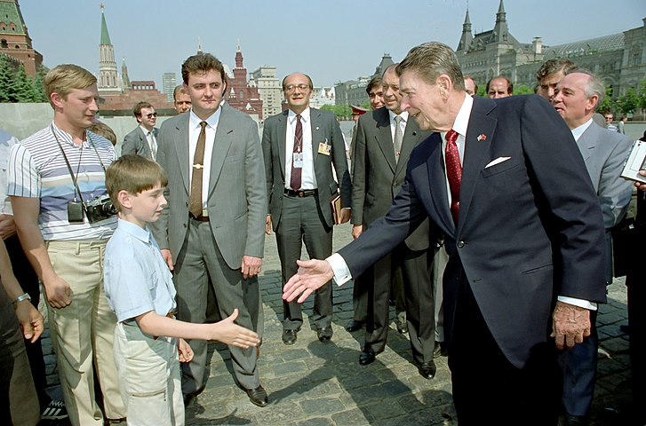 President Ronald Reagan greets a young boy while touring Red Square during the Moscow Summit in the USSR.jpg