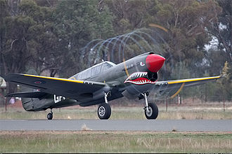 No. 112 Squadron RAF - A restored P-40N painted in RAF 112 Squadron later (from 1943 onwards) green livery taking off at Temora, New South Wales