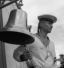 2bd574ff31 Soviet Pacific Fleet sailor in full dress, including a dark-blue  telnyashka. The Russian telnyashka originated in the distinctive striped  marinière blouse ...