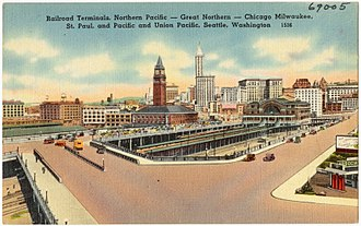 International District/Chinatown station - Postcard depiction of King Street Station and Union Station in the late 1930s, including the future site of International District/Chinatown station