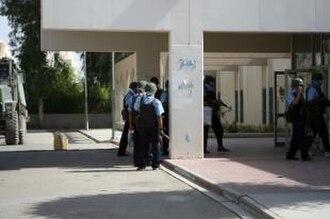 Battle of Ramadi (2006) - Iraqi police prepare to enter the Ramadi hospital, July 5, 2006.