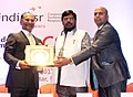 Ramdas Athawale presenting the India CSR Leadership award to the Neem project of Gujrat Narmada Valley Fertilizers and Chemicals Limited, at the India CSR Leadership Summit, in Mumbai.jpg