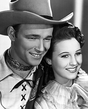 Singing cowboy - Roy Rogers and Mary Hart in Shine On, Harvest Moon (1938)