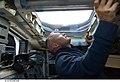 STS-127 Hurley looks through overhead window.jpg