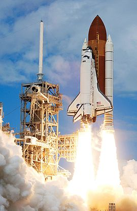 Space Shuttle Discovery launches at the start of STS-120.