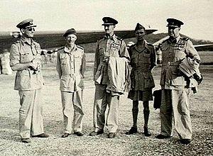 Hugh Saunders - Air Marshal Sir Hugh Saunders (far right), Air Vice Marshal Adrian Cole (far left) as RAAF Liaison Officer to SEAC, with Air Chief Marshal Sir Keith Park (centre), near Penang, c. August 1945