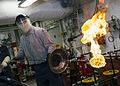 Sailor ignites the number one boiler aboard USS Bonhomme Richard. (29777250366).jpg