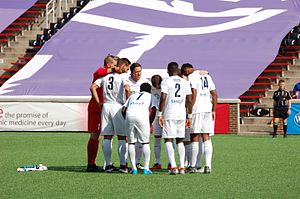 Saint Louis FC - Saint Louis FC players in a huddle prior to a match kickoff