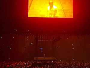 "Saint Pablo Tour - West seen on the ""floating"" main stage with the secondary stage shining down above him."