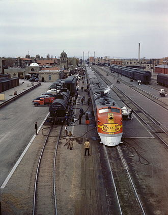 "Super Chief - Super Chief being serviced at Albuquerque, New Mexico, in March 1943. A headlight ""blackout shield"" was a wartime Civil Defense requirement on trains running to the Pacific Coast."