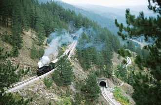 Heritage railway - Steam hauled train climbing the Šargan Eight, Serbia