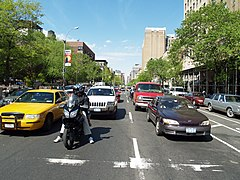 vehicles stopped at a red traffic signal on Second Avenue in Manhattan