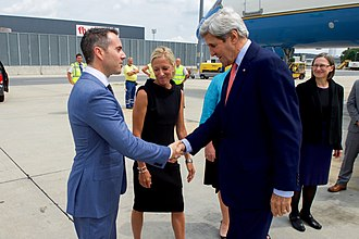 Dan Baer - Image: Secretary Kerry Shakes Hands With U.S. Ambassador for Security and Co operation Baer After Arriving at the Vienna International Airport (28364677682)