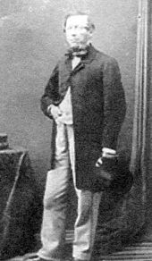 Full-length photograph of a smartly dressed middle-aged man