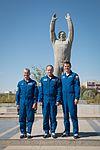 Soyuz MS-02 backup crew in front of a statue of Yuri Gagarin.jpg