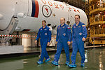 Soyuz TMA-10M crew during the 'fit check'.jpg