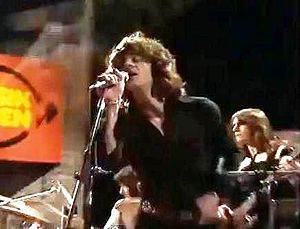 Spooky Tooth - Singer Mike Harrison on stage with the band in the 1970s