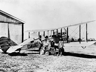 Cloncurry Airport - QANTAS biplane at Cloncurry, 1923 Airco de Havilland DH.9C G-AUEF was acquired by QANTAS in 1923 for the Charleville - Cloncurry route. Pilot, Captain G. Matthews is on the left and Mr. A. N. Templeton is on the right.