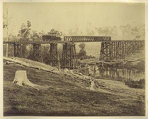North Coast railway line, Queensland - Locomotive on the recently constructed railway bridge over Graham Creek (north of Mungar Junction), 1882