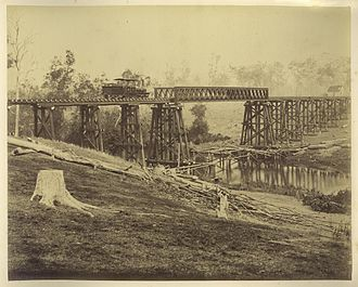 North Coast railway line, Queensland - Locomotive on the recently constructed railway bridge over Graham Creek (north of Mungar Junction), 1882