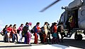 Stranded medical students rescued and being taken by IAF MI-17 V5 helicopter for onward routing to their destination during Rescue and Relief operation, in J&K on September 13, 2014.jpg