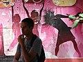 Street Scene with Young Man and Mural - Shkodra - Albania (41866444474).jpg