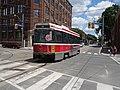 Streetcar passes the NE corner of Parliament and King, 2016 07 02 (3).JPG - panoramio.jpg