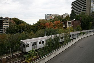 Studio Building (Toronto) - Whereas the Studio Building was once nestled in a serene valley, trains now rattle along Toronto's nearby Yonge Street subway line every minute or so.