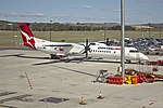 Sunstate Airlines 'QantasLink livery' (VH-QOX) Bombardier Dash-8 Q402 at Canberra Airport.jpg