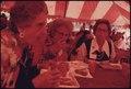 THREE MEMBERS OF A GERMAN GROUP FROM SAVANNAH, GEORGIA EAT WURST, SAUERKRAUT, PRETZELS AND DRINK SOFT DRINKS IN A... - NARA - 557795.tif