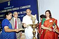 The Minister of Consumer Affairs, Food and Public Distribution Shri Sharad Pawar lighting a traditional lamp to inaugurate a Conference of Presidents.jpg