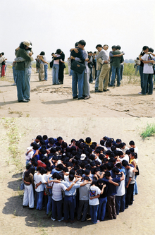 Photography of the Gao Brothers performance, The Utopia Of the 20 Minute Embrace, 2000